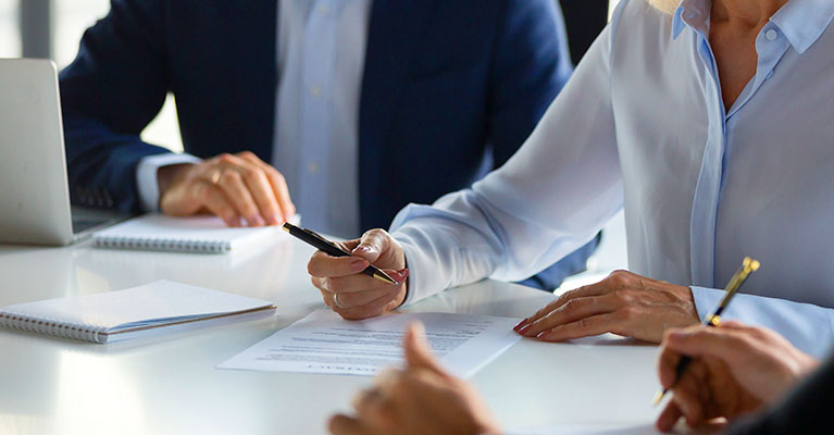 services-hands-signing-paperwork